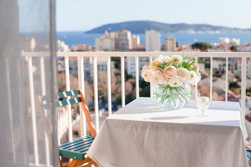 white and pink flowers on white table cloth