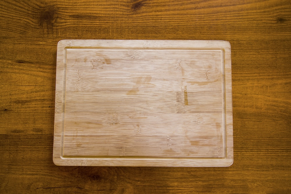 brown wooden tray on brown wooden table