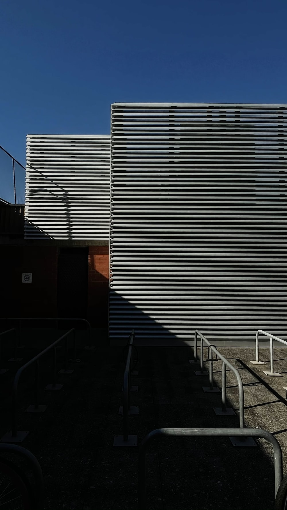 white metal railings near white and brown concrete building during daytime