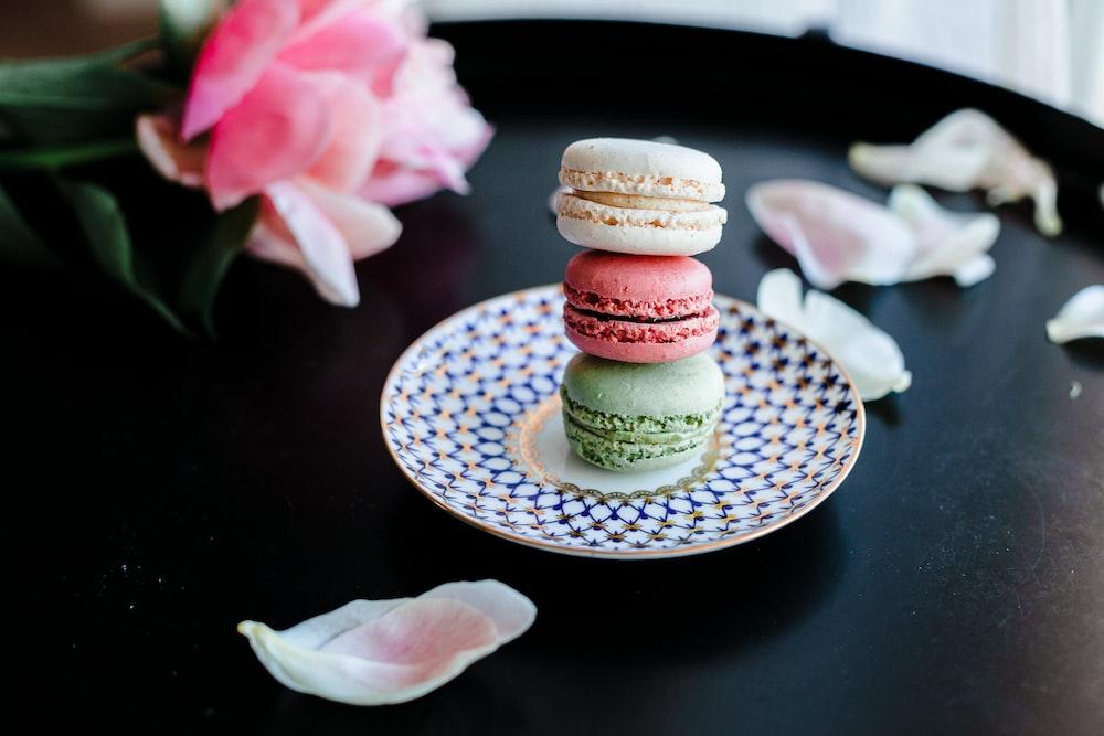 pink and white cupcake on white ceramic saucer
