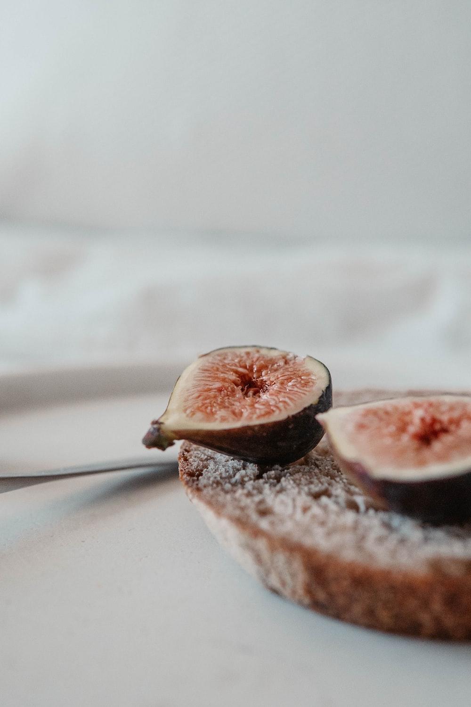 brown and white fruit on white textile