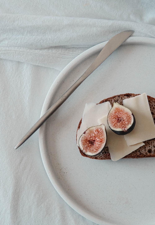 sliced bread with sliced fruit on white ceramic plate