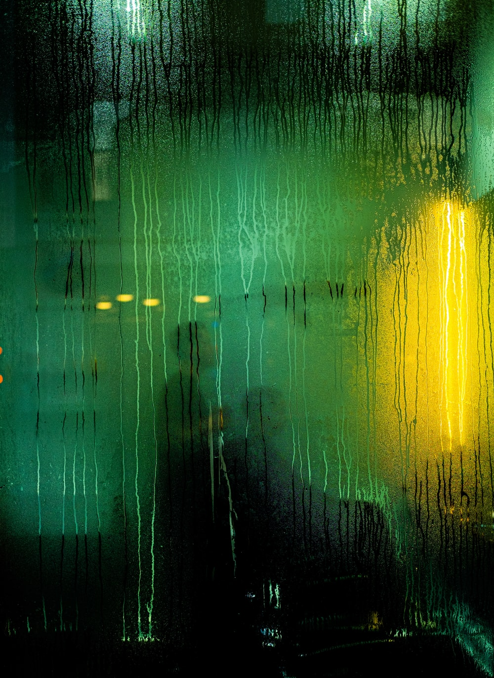 green and yellow lights on a dark room