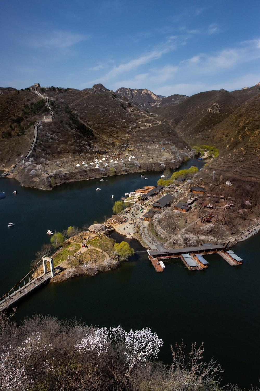 aerial view of brown wooden bridge on lake