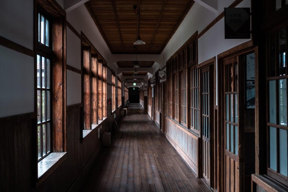 brown wooden hallway with light fixture