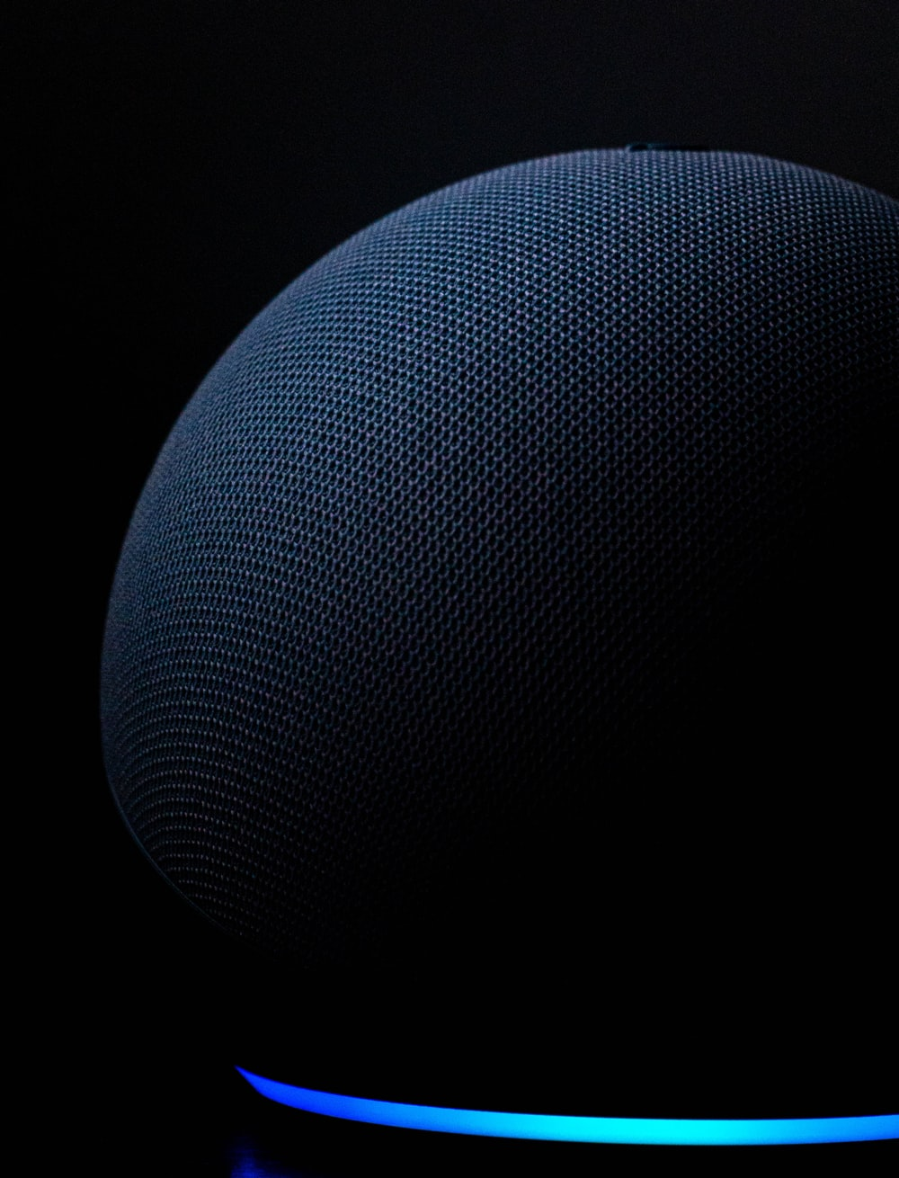 blue round textile on black background