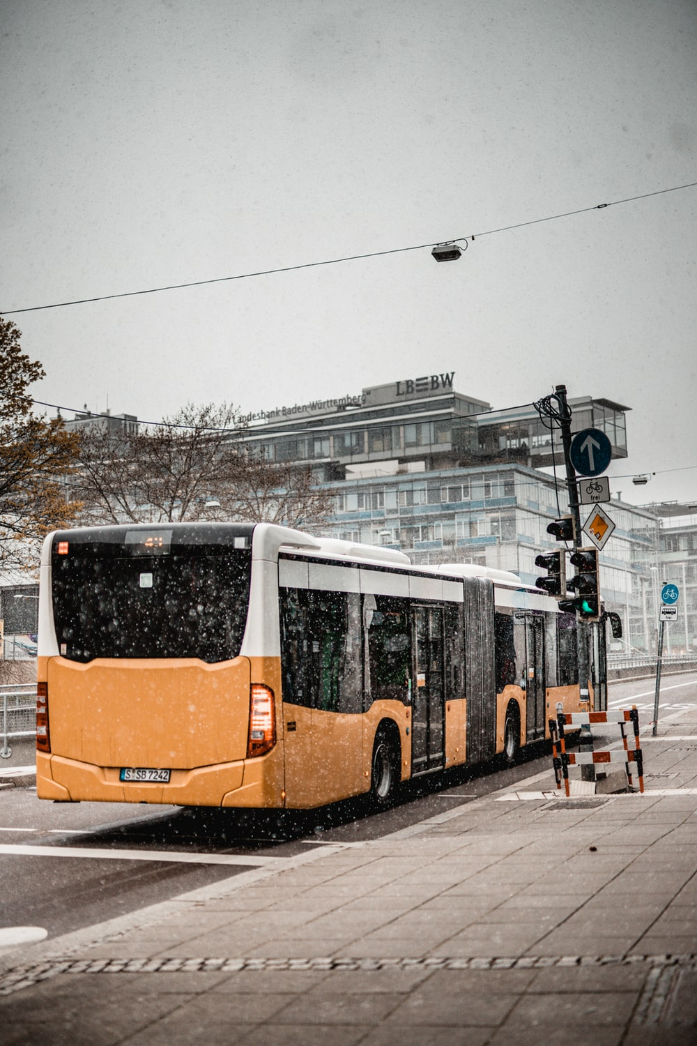 orange and white bus on road during daytime
