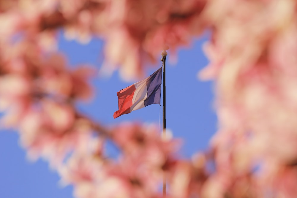 red white and blue flag on pole