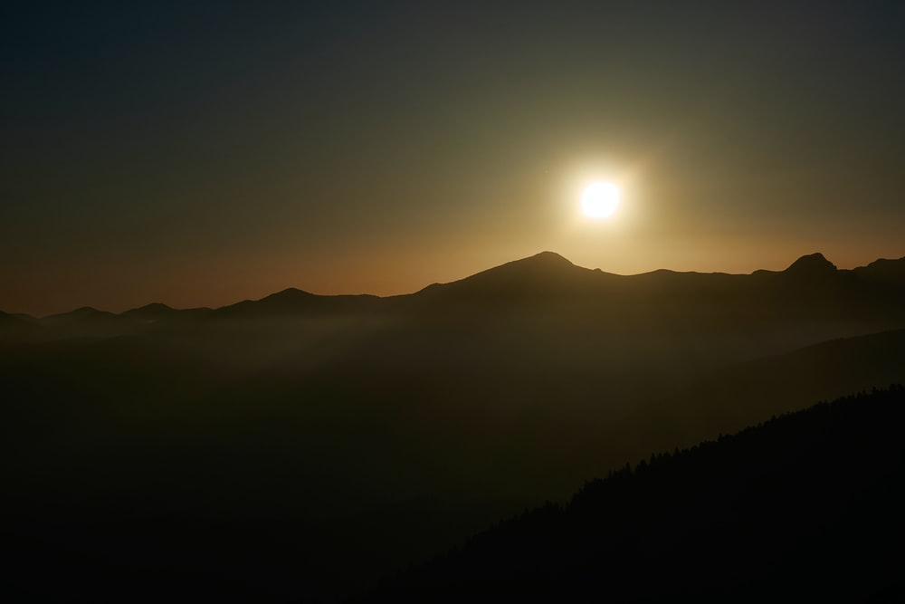sun over the mountains during sunrise