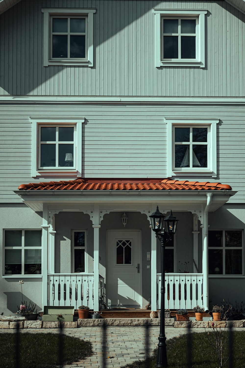 white wooden house with white wooden fence
