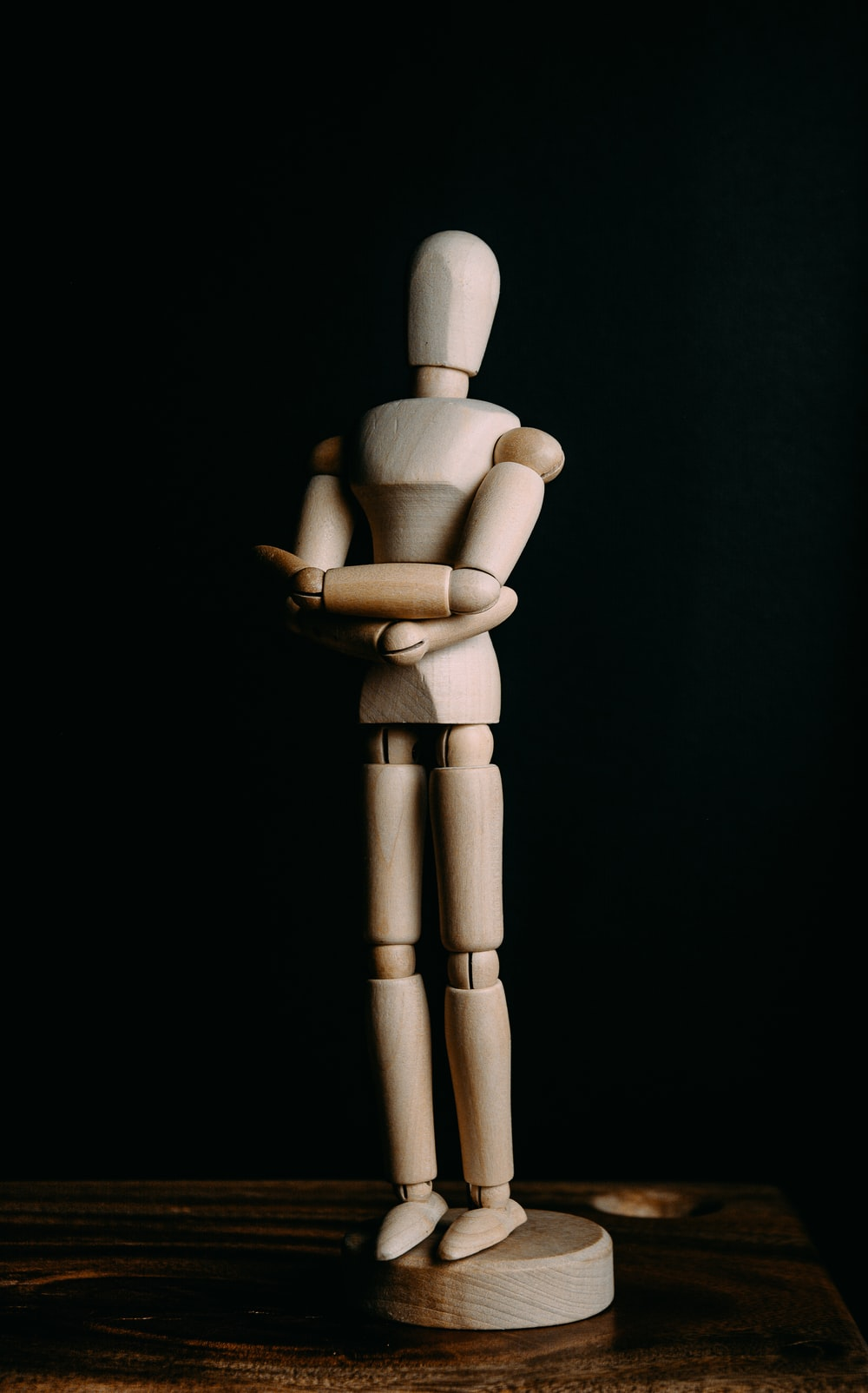 brown wooden human form figurine