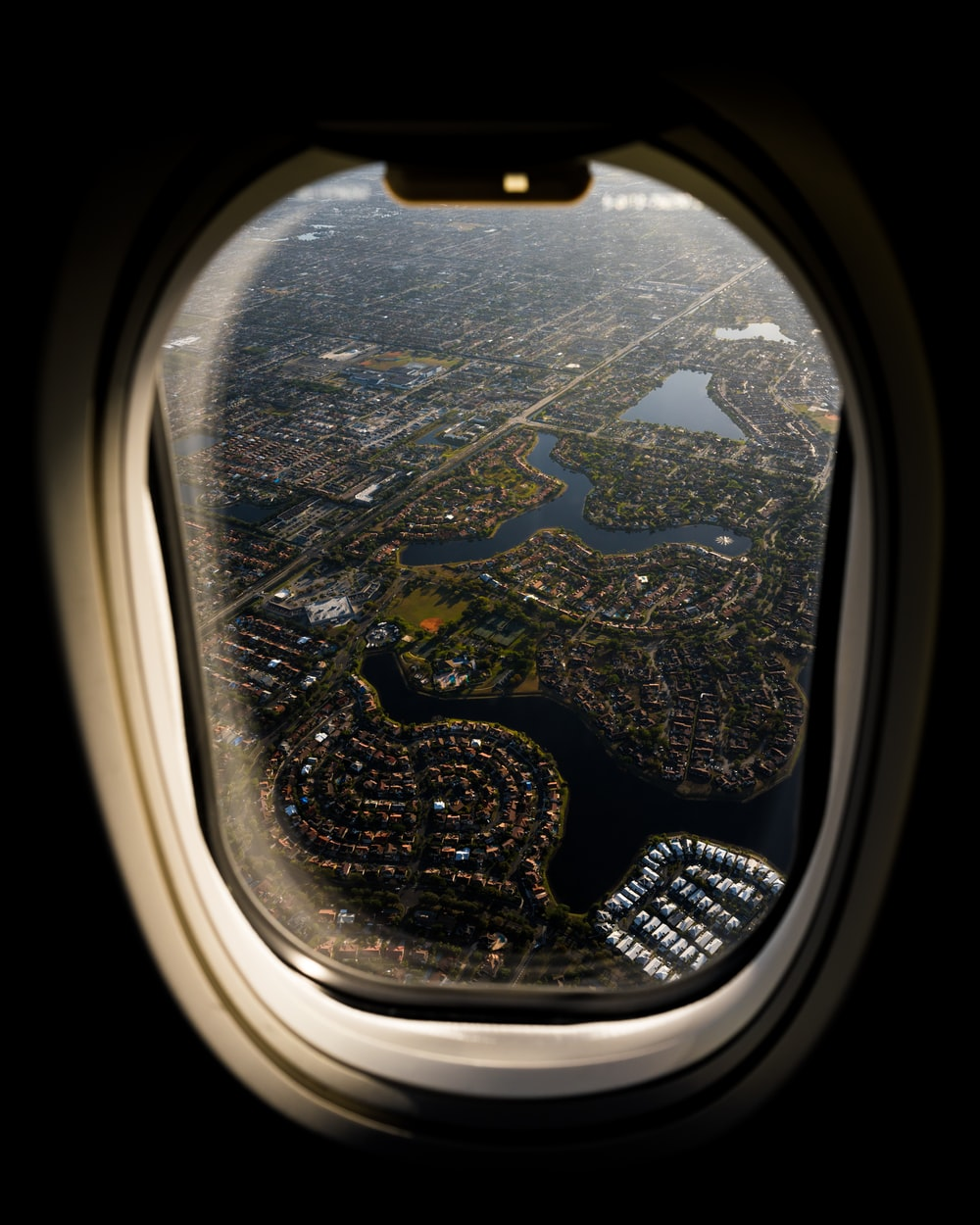 airplane window view of city during daytime