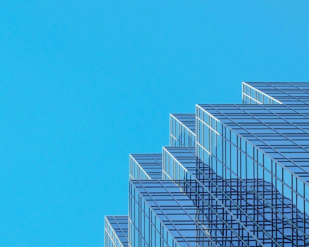 white and blue concrete building under blue sky during daytime