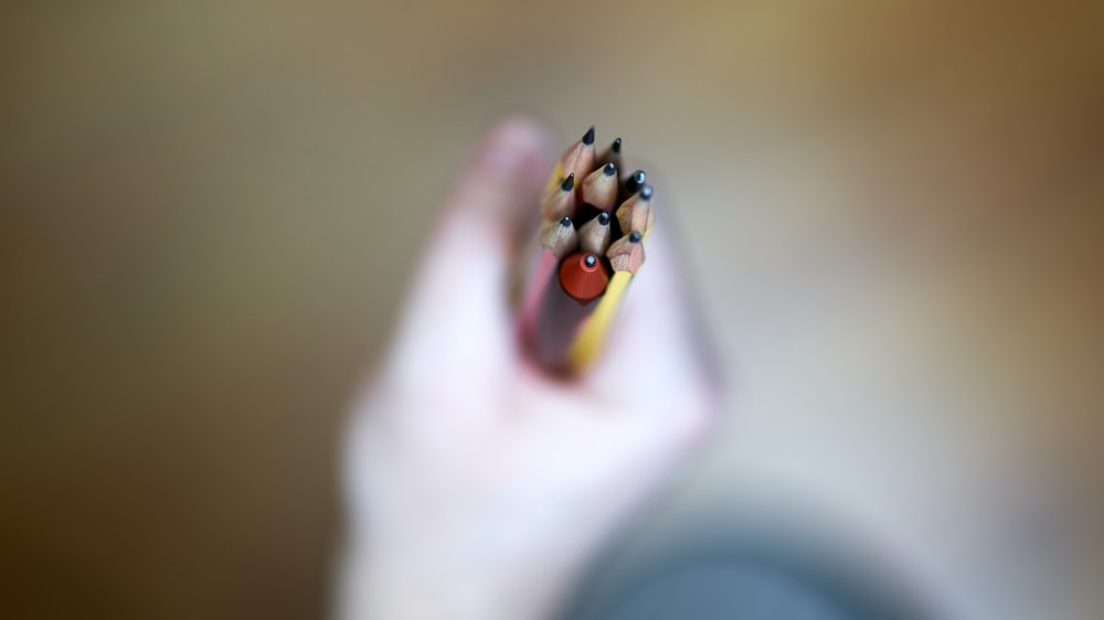 person holding brown and black beads