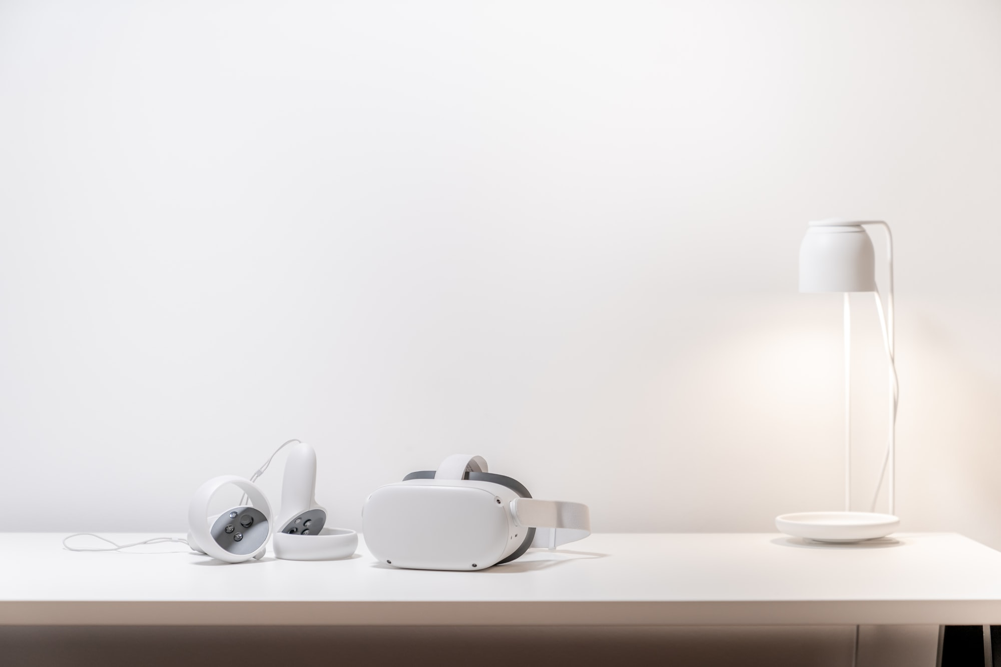 oculus quest 2 on white desk with lamp