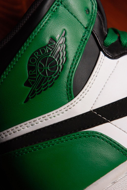 green and white nike shoe
