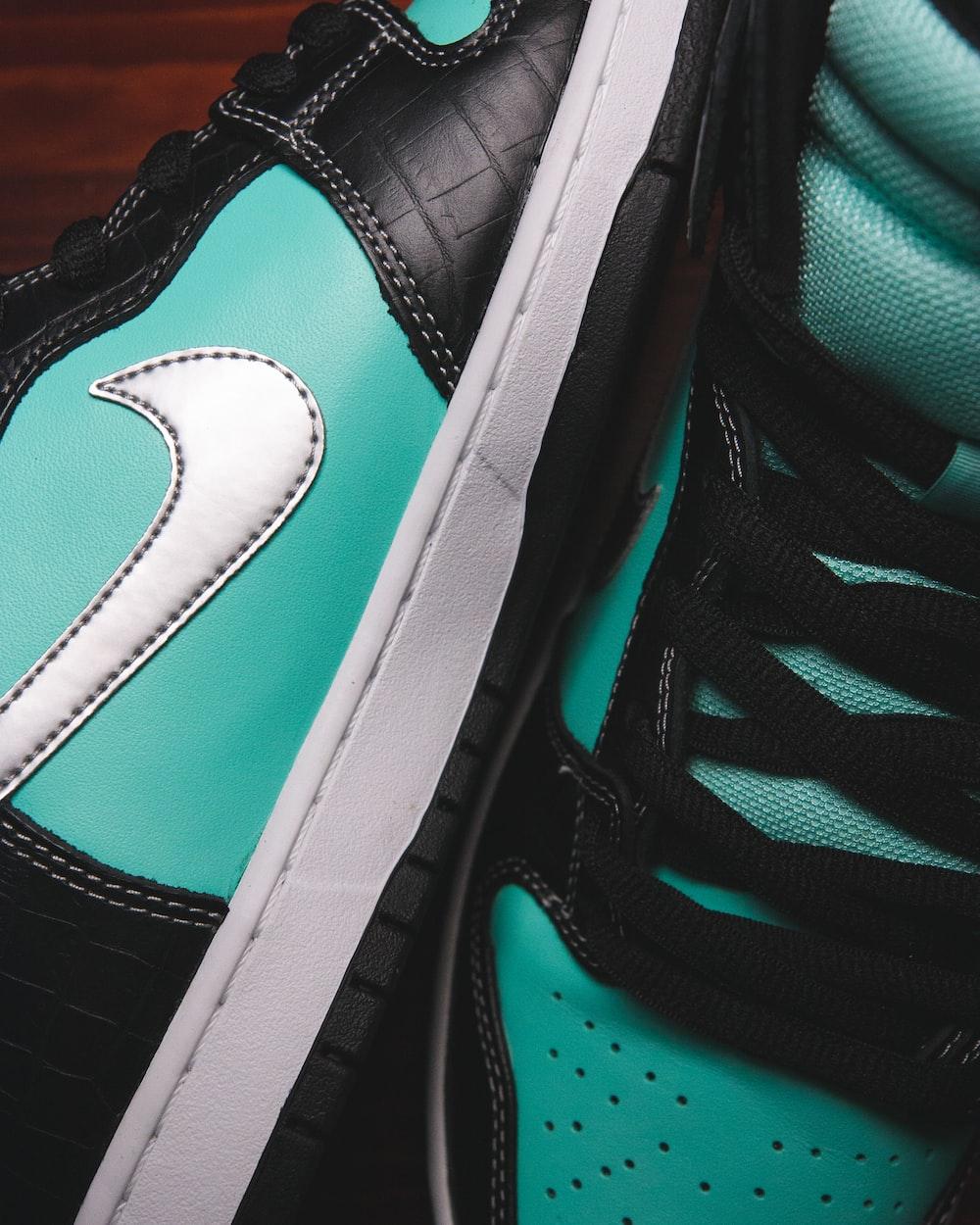 black and green nike shoe
