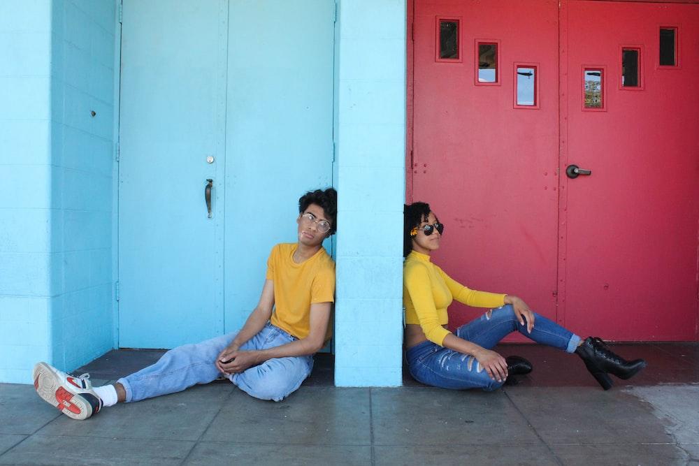 man in yellow polo shirt sitting beside woman in yellow shirt