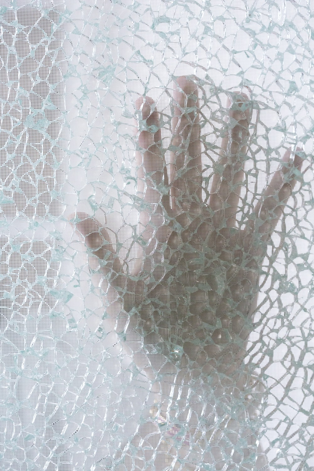 persons hand on glass