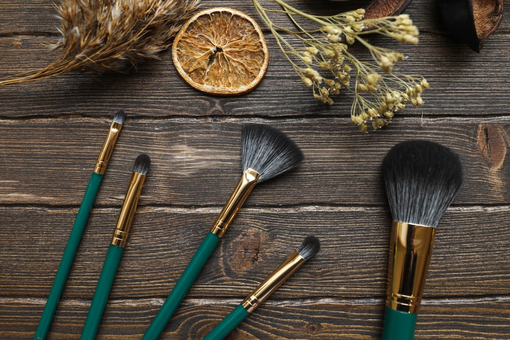 green and brown makeup brushes