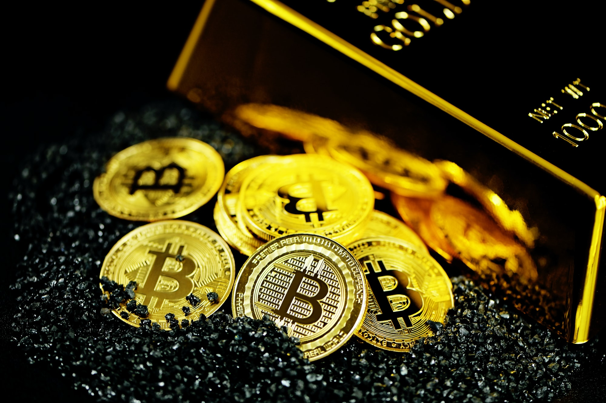 Bitcoin coin in black with a shining gold
