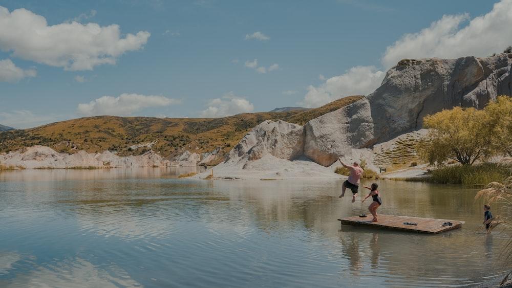 people riding on boat on lake during daytime