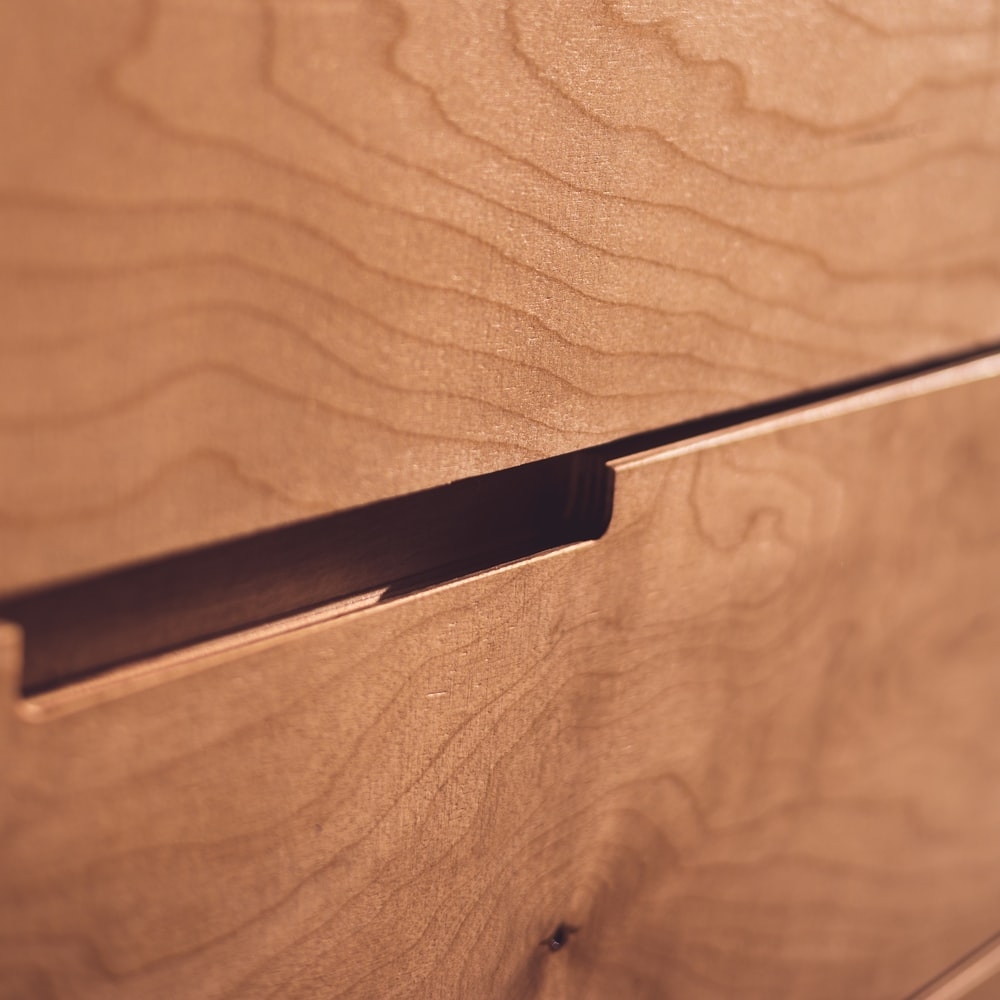 black metal bar on brown wooden table