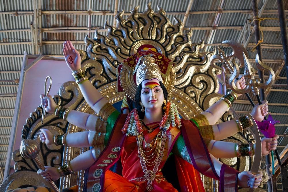hindu deity statue in front of brown building