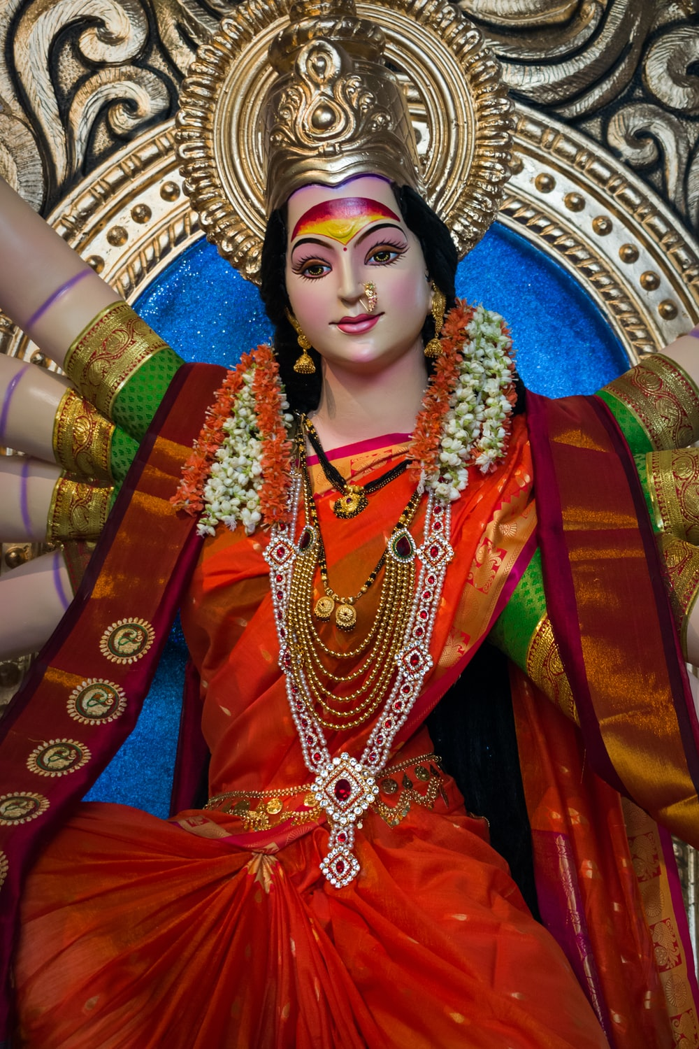 woman in red and gold sari