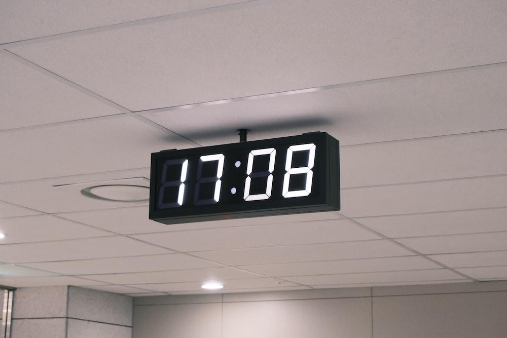 black and white digital clock at 11 00