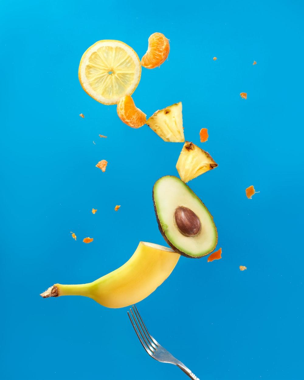 sliced lemon fruit on blue surface