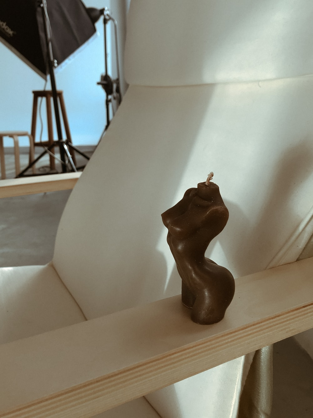 brown wooden animal figurine on white table