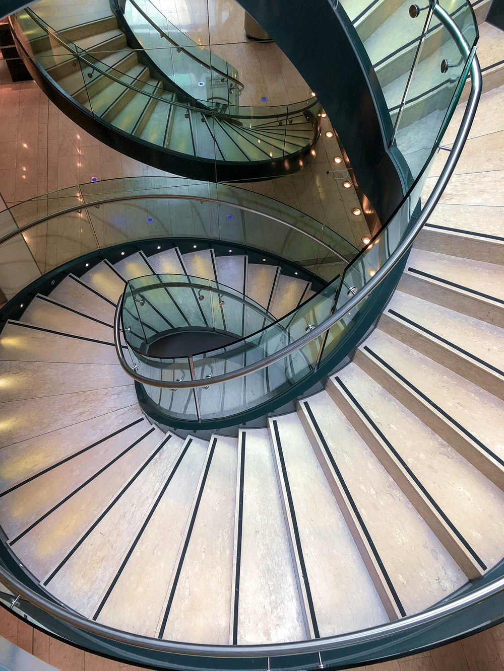 gray spiral staircase with brown wooden railings