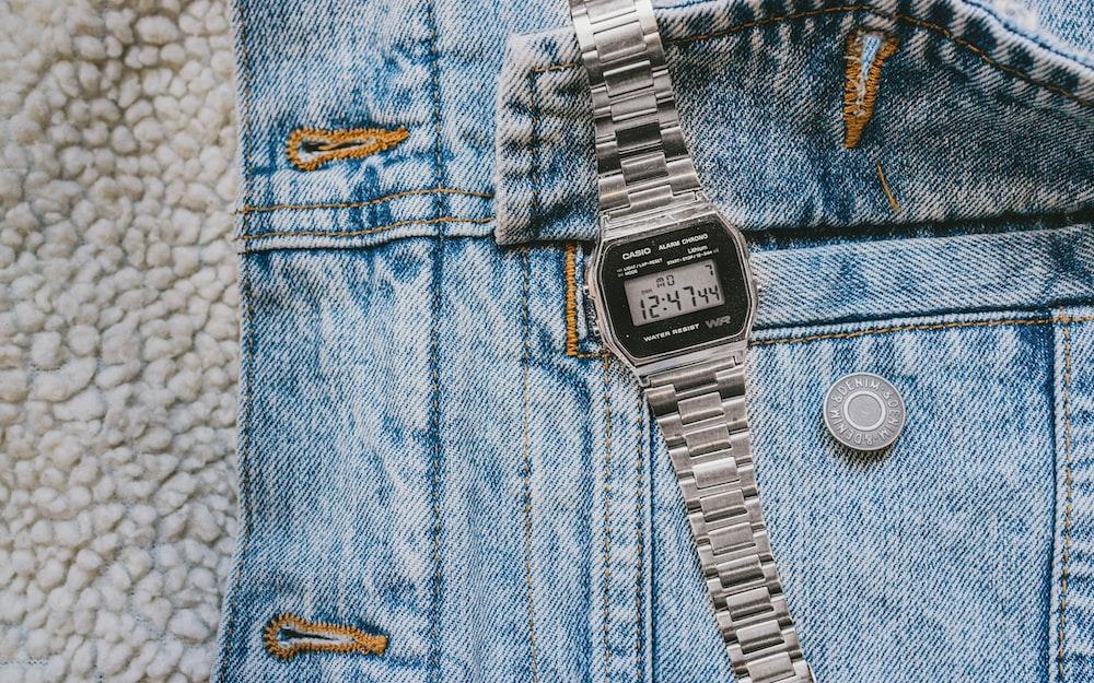 silver digital watch at 11 00