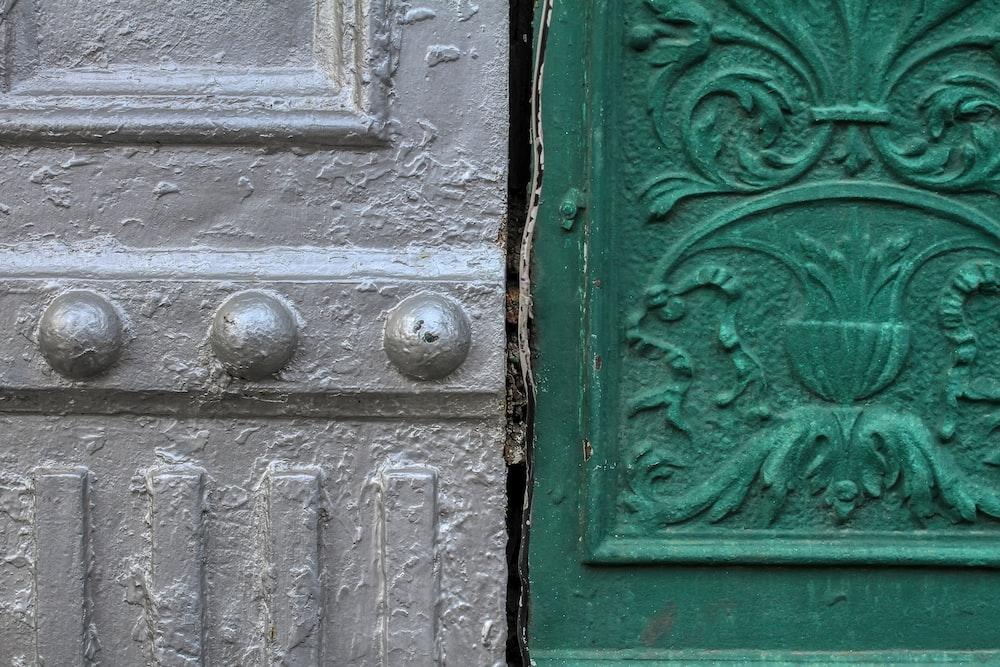 green wooden door with silver door knob