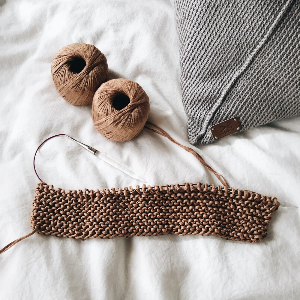 brown and white knit textile