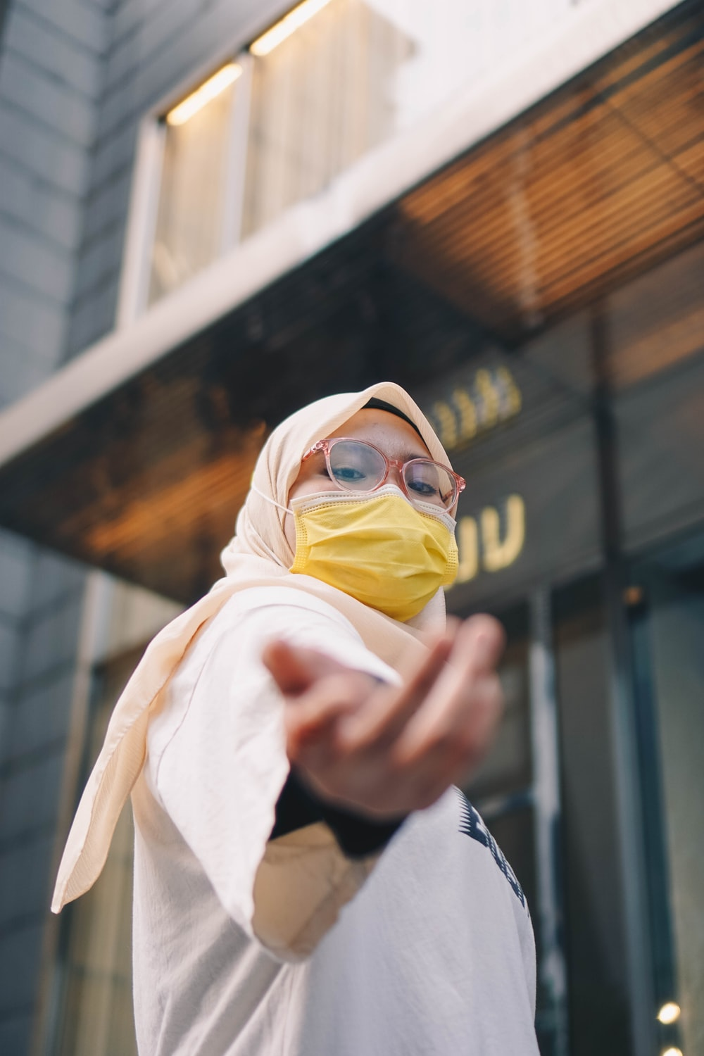 person in white hijab and black framed eyeglasses