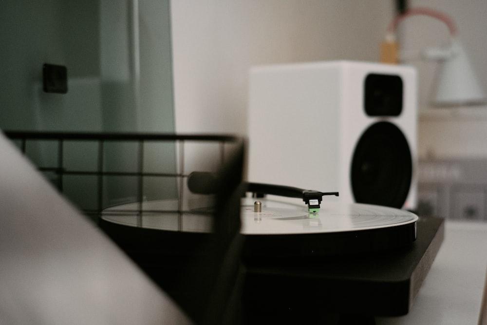 black and white speaker on table
