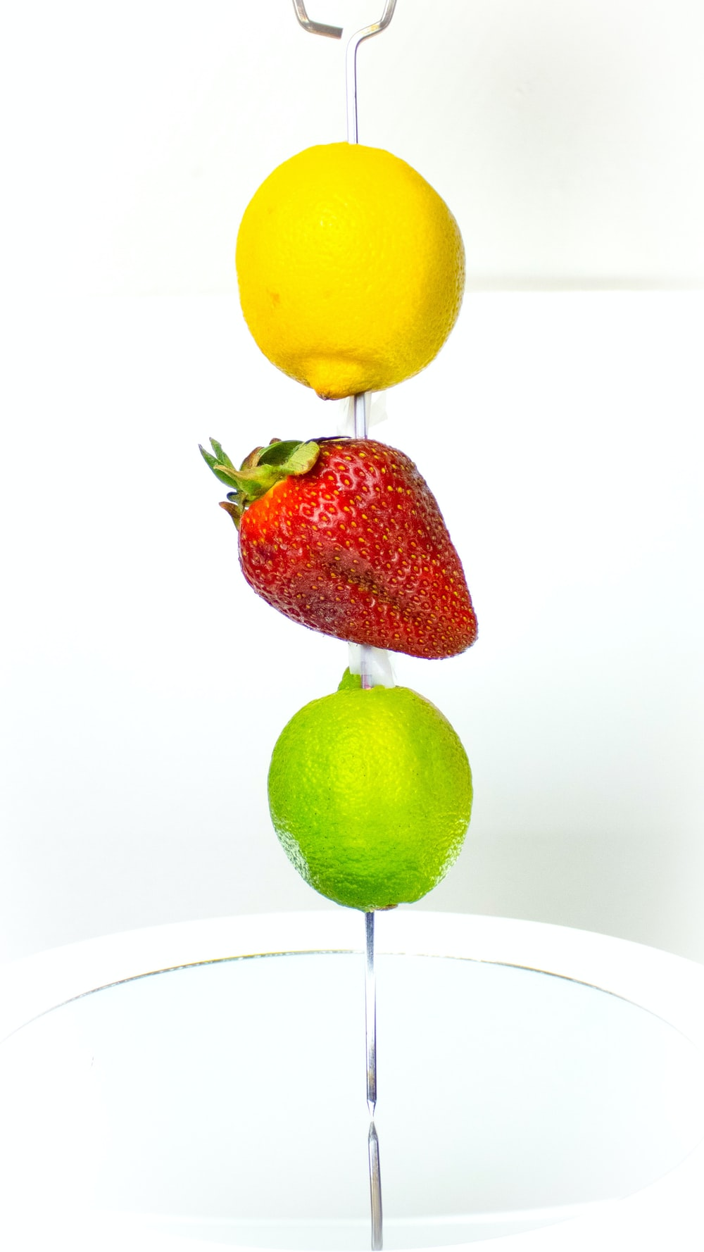 red strawberry and yellow lemon fruit
