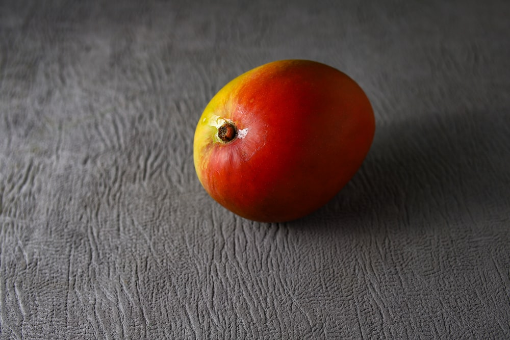 red tomato on black leather textile