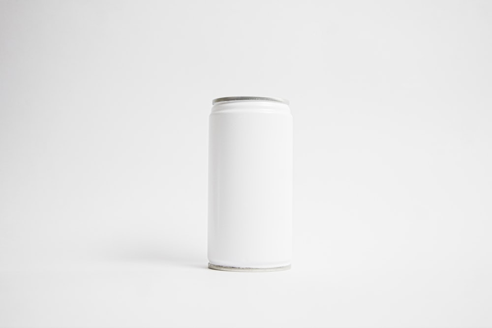 white cylindrical container on white surface