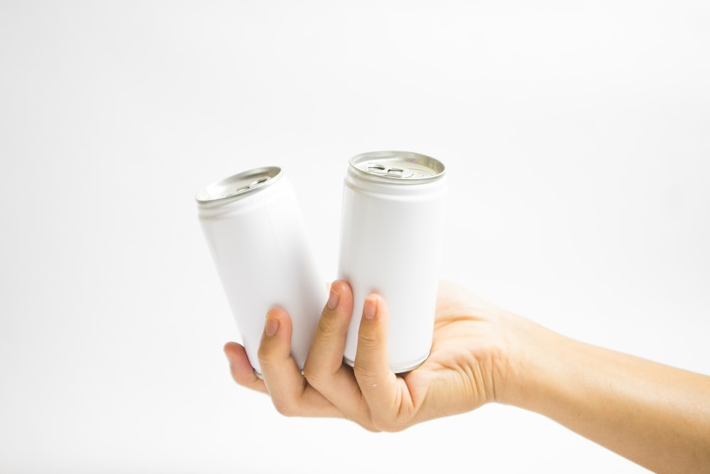 person holding white paper roll