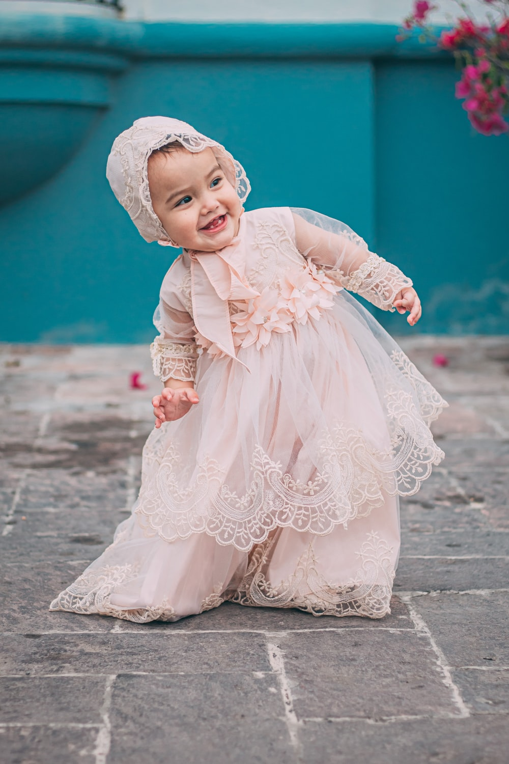 girl in pink dress and white floral hijab