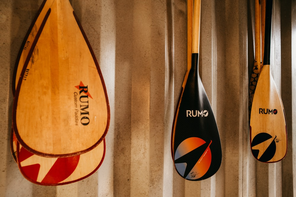 brown and black wooden surfboard