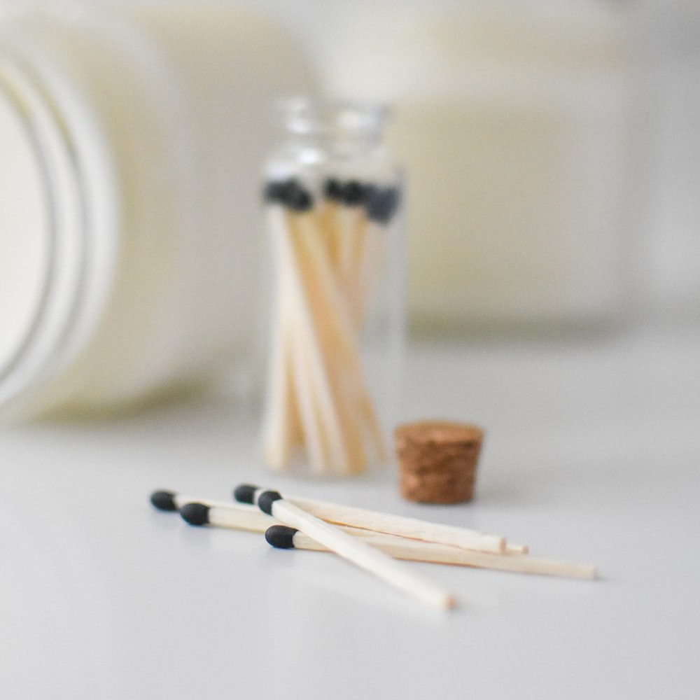 white candles on white ceramic plate