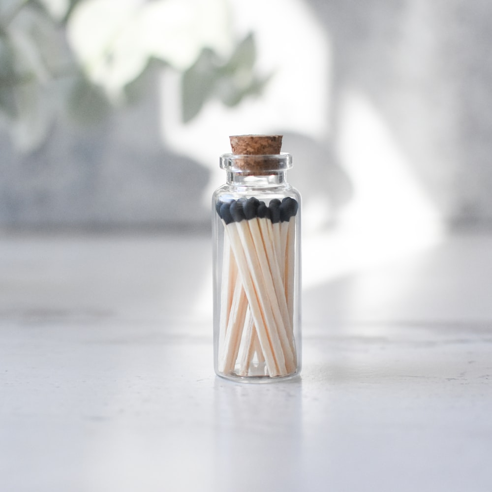 brown and white condiment shaker
