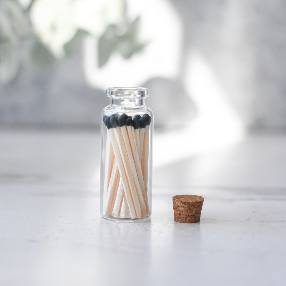 clear glass condiment shaker on white table