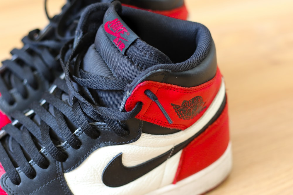 black white and red nike athletic shoe
