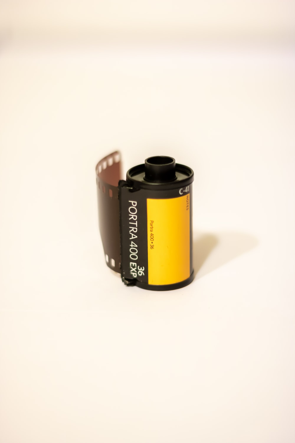 black and yellow labeled can