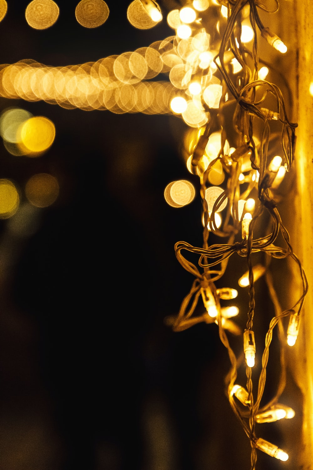 yellow string lights in bokeh photography